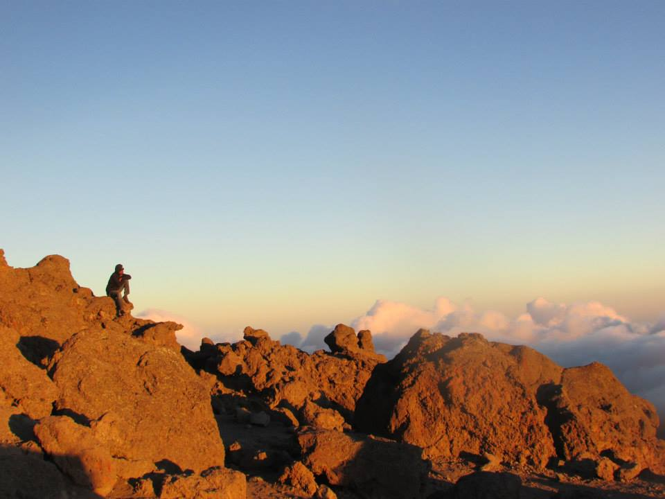A Kilimanjaro porter, enjoying the view above the clouds at Barafu Camp, Kilimanjaro's base camp.